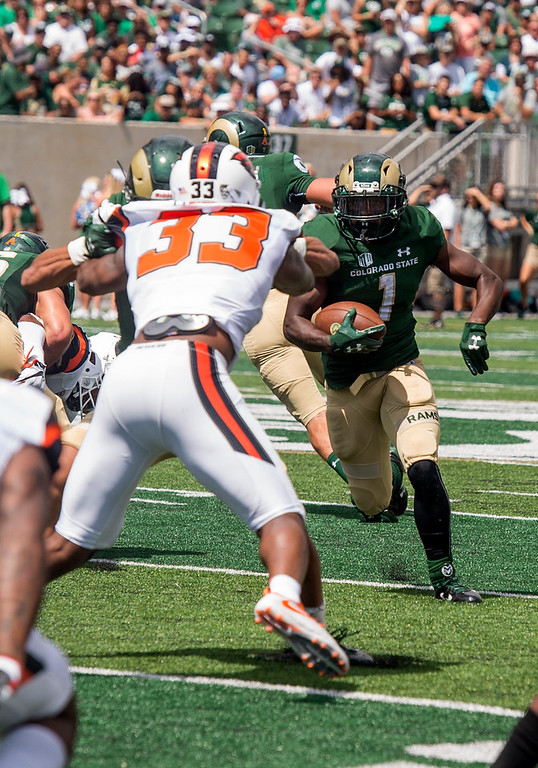 . Colorado State running back Dalyn Dawkins (1) rounds the corner against Orgeon State Saturday afternoon August 26, 2017 in Fort Collins. The Rams beat the Beavers in their new stadium\'s home opener 58-27. (Michael Brian/For the Reporter-Herald)