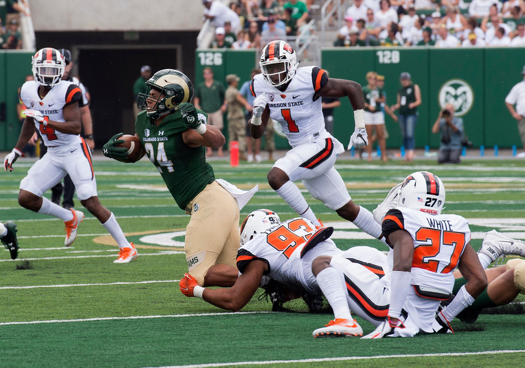 . Colorado State running back Izzy Matthews (24) gets tripped up by Oregon State defensive end Titus Failauga (93) Saturday afternoon August 26, 2017 at the new on-campus stadium in Fort Collins. The Rams beat the Beavers, 58-27. (Michael Brian/For the Reporter-Herald)