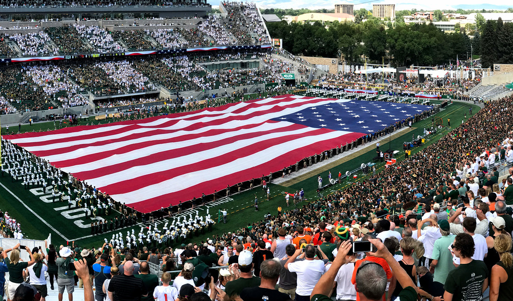 . Colorado State rolled out a full-field flag for the national anthem before Saturday\'s opener against Oregon State on Aug. 26, 2017 at Colorado State Stadium. (Cris Tiller / Loveland Reporter-Herald)