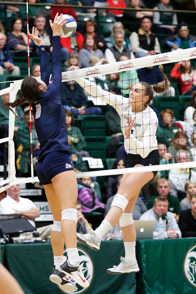 CSU's Paulina Hougaard-Jensen (11) spikes the ball back to Frenso State's Taylor Slover (8) on Wednesday, Nov. 15, 2017 at the McGraw Athletic Center in Fort Collins. (Photo by Lauren Cordova/Loveland Reporter-Herald)