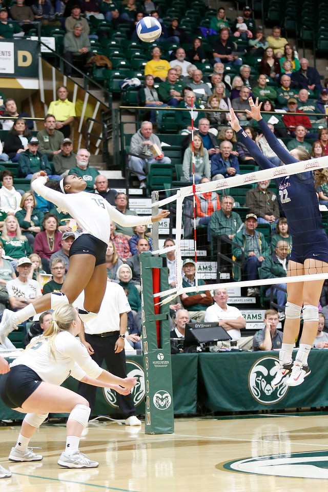 CSU's Breana Runnels (15) hits the ball back to Fresno State's Aubrey Folk (22) on Wednesday, Nov. 15, 2017 at the McGraw Athletic Center in Fort Collins. (Photo by Lauren Cordova/Loveland Reporter-Herald)