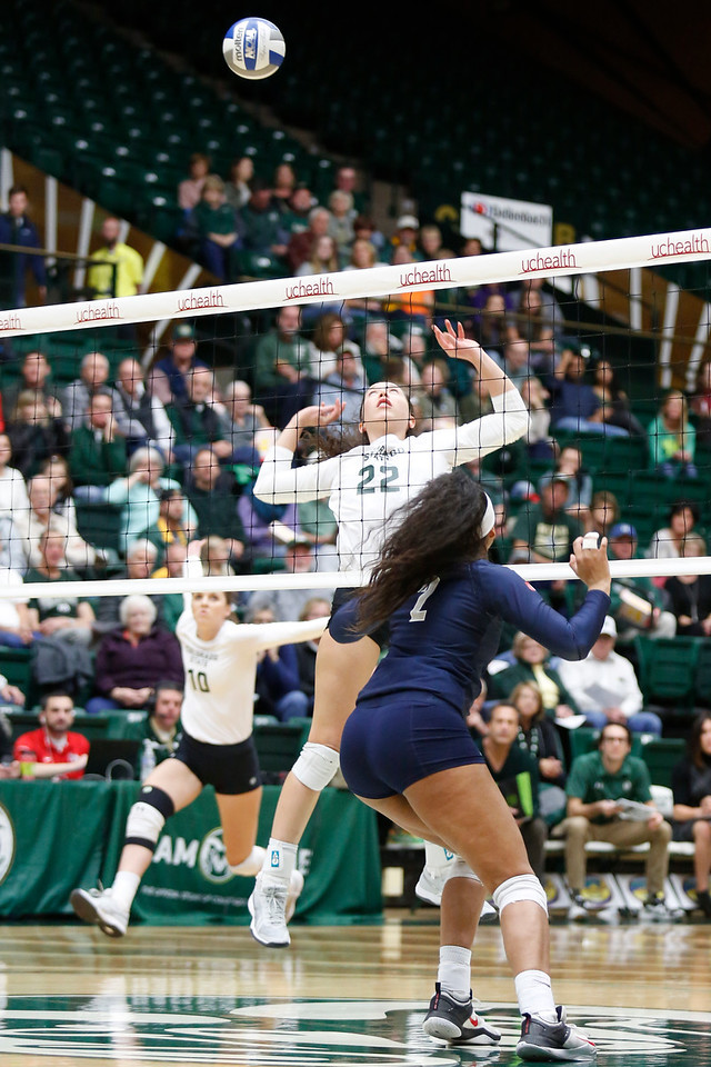 CSU's Katie Oleksak (22) reached back to set up the ball against Fresno State's Lauren Torres (2) on Wednesday, Nov. 15, 2017 at the McGraw Athletic Center in Fort Collins. (Photo by Lauren Cordova/Loveland Reporter-Herald)