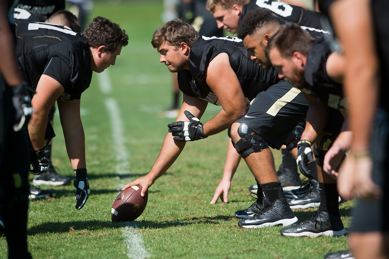 "Players warm up during a drill at the practice field on the CU Boulder Campus on Saturday. <br /> For more photos go to  <a href=""http://www.dailycamera.com"">http://www.dailycamera.com</a><br /> (Autumn Parry/Staff Photographer)<br /> August 20, 2016"