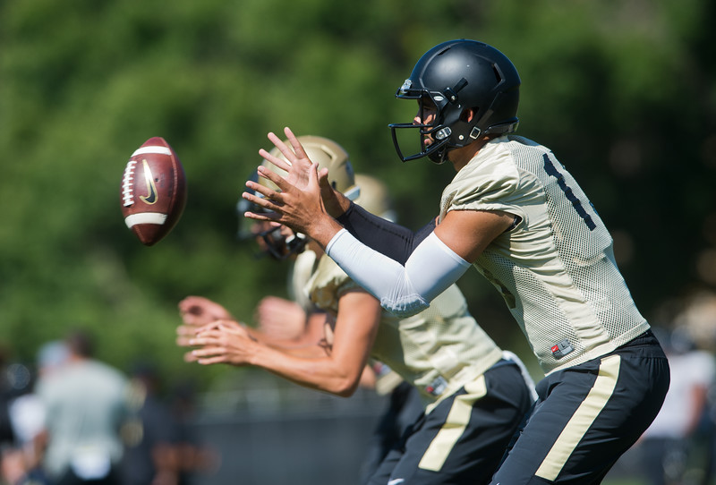 "Quarterback Sefo Liufau catches a pass during a practice drill at the CU Boulder Campus on Saturday.<br /> For more photos go to  <a href=""http://www.dailycamera.com"">http://www.dailycamera.com</a><br /> (Autumn Parry/Staff Photographer)<br /> August 20, 2016"