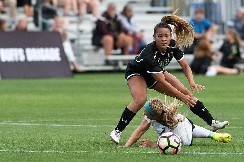 "Hawaii's Raisa Strom-Okimoto falls over CU's Danica Evans during the game at CU Boulder's Prentup Field on Friday. CU defeated Hawaii 3-1. <br /> More photos:  <a href=""http://www.buffzone.com"">http://www.buffzone.com</a><br /> (Autumn Parry/Staff Photographer)<br /> September 9, 2016"