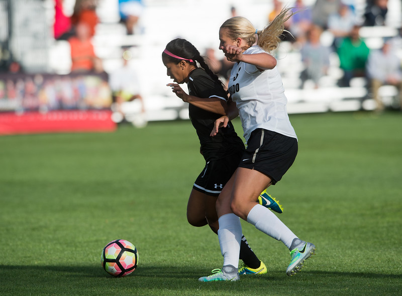 "Hawaii's T.J. Reyno and CU's Emily Bruder fight for possession of the ball during the game at CU Boulder's Prentup Field on Friday. CU defeated Hawaii 3-1. <br /> More photos:  <a href=""http://www.buffzone.com"">http://www.buffzone.com</a><br /> (Autumn Parry/Staff Photographer)<br /> September 9, 20161"
