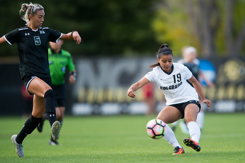 "CU's Stephanie Zuniga kicks the ball past Hawaii's Sarah Lau during the game at CU Boulder's Prentup Field on Friday. CU defeated Hawaii 3-1. <br /> More photos:  <a href=""http://www.buffzone.com"">http://www.buffzone.com</a><br /> (Autumn Parry/Staff Photographer)<br /> September 9, 2016"