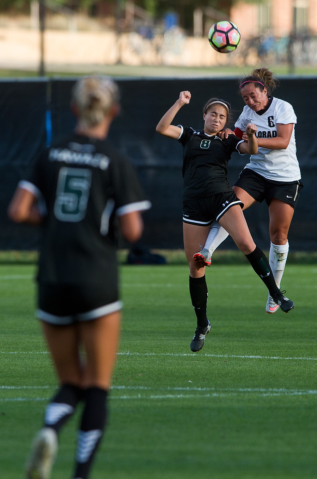 "CU's Morgan Stanton and Hawaii's Sonest Furtado head bump the ball during the game at CU Boulder's Prentup Field on Friday. CU defeated Hawaii 3-1. <br /> More photos:  <a href=""http://www.buffzone.com"">http://www.buffzone.com</a><br /> (Autumn Parry/Staff Photographer)<br /> September 9, 2016"