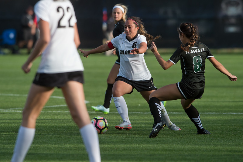 "CU's Morgan Stanton kicks the ball away from Hawaii's defense during the game at CU Boulder's Prentup Field on Friday. CU defeated Hawaii 3-1. <br /> More photos:  <a href=""http://www.buffzone.com"">http://www.buffzone.com</a><br /> (Autumn Parry/Staff Photographer)<br /> September 9, 2016"