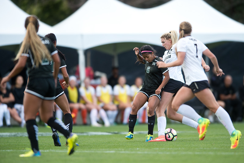 "CU's Taylor Kornieck kicks the ball past Hawaii's T.J. Reyno during the game at CU Boulder's Prentup Field on Friday. CU defeated Hawaii 3-1. <br /> More photos:  <a href=""http://www.buffzone.com"">http://www.buffzone.com</a><br /> (Autumn Parry/Staff Photographer)<br /> September 9, 2016"