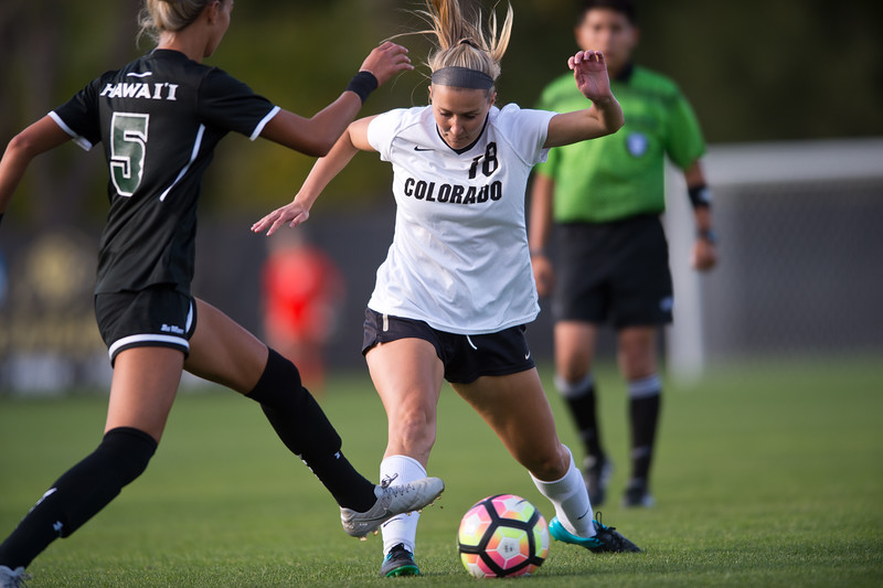 """CU's Mikaela Kraus kicks the ball past Hawaii's Sarah Lau during the game at CU Boulder's Prentup Field on Friday. CU defeated Hawaii 3-1. <br /> More photos:  <a href=""""http://www.buffzone.com"""">http://www.buffzone.com</a><br /> (Autumn Parry/Staff Photographer)<br /> September 9, 2016"""