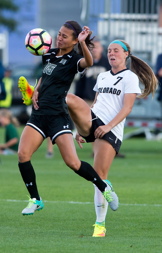 "Hawaii's Madison Reed and CU's Danica Evans go after the ball during the game at CU Boulder's Prentup Field on Friday. CU defeated Hawaii 3-1. <br /> More photos:  <a href=""http://www.buffzone.com"">http://www.buffzone.com</a><br /> (Autumn Parry/Staff Photographer)<br /> September 9, 2016"