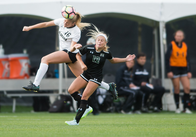 "CU's Erin Greening and Hawaii's Addie Steiner head bump the ball during the game at CU Boulder's Prentup Field on Friday. CU defeated Hawaii 3-1. <br /> More photos:  <a href=""http://www.buffzone.com"">http://www.buffzone.com</a><br /> (Autumn Parry/Staff Photographer)<br /> September 9, 2016"
