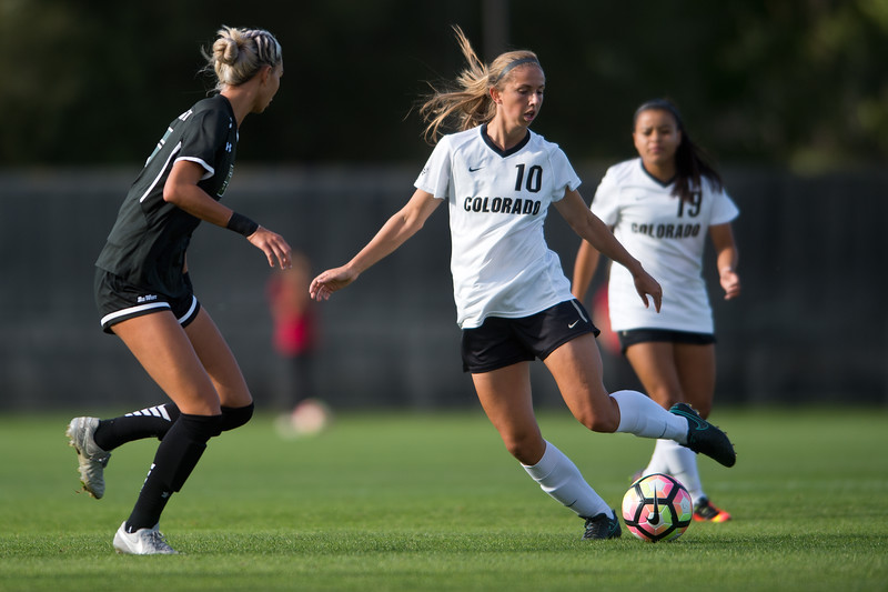 "CU's Sarah Kinzner kicks the ball past Hawaii's Sarah Lau during the game at CU Boulder's Prentup Field on Friday. CU defeated Hawaii 3-1. <br /> More photos:  <a href=""http://www.buffzone.com"">http://www.buffzone.com</a><br /> (Autumn Parry/Staff Photographer)<br /> September 9, 2016"