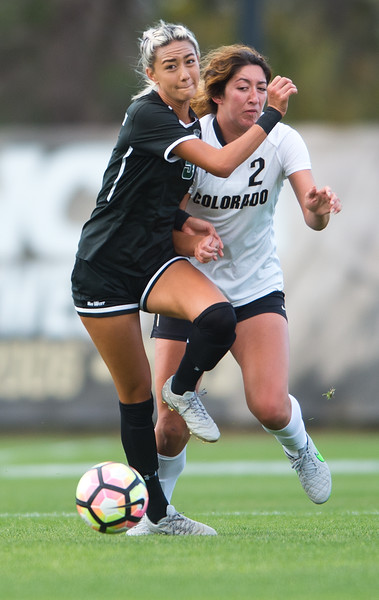 "CU's Joss Orejel and Hawaii's Sarah Lau try to gain possession of the ball during the game at CU Boulder's Prentup Field on Friday. CU defeated Hawaii 3-1. <br /> More photos:  <a href=""http://www.buffzone.com"">http://www.buffzone.com</a><br /> (Autumn Parry/Staff Photographer)<br /> September 9, 2016"