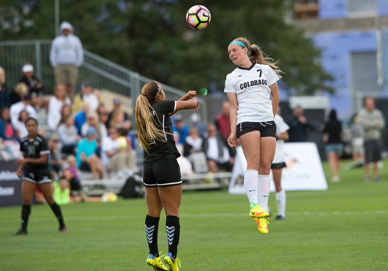 "CU's Danica Evans head bumps the ball during the game at CU Boulder's Prentup Field on Friday. CU defeated Hawaii 3-1. <br /> More photos:  <a href=""http://www.buffzone.com"">http://www.buffzone.com</a><br /> (Autumn Parry/Staff Photographer)<br /> September 9, 2016"