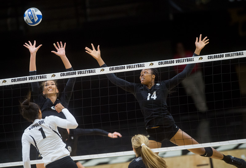 "Naghede Abu (right) and her teammate make a save during the volleyball scrimmage at the Coors Event Center at CU Boulder on Saturday.<br /> For more photos go to  <a href=""http://www.BoCoPreps.com"">http://www.BoCoPreps.com</a><br /> (Autumn Parry/Staff Photographer)<br /> August 20, 2016"