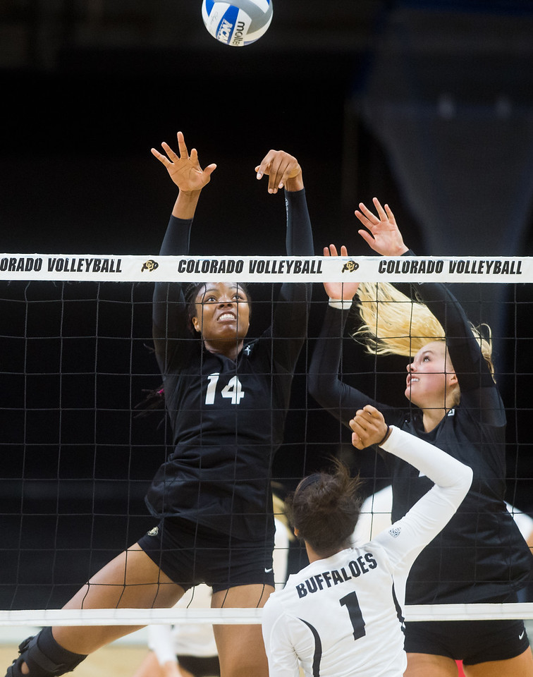 "Naghede Abu hits one past Frankie Shebby during the volleyball scrimmage at the Coors Event Center at CU Boulder on Saturday.<br /> For more photos go to  <a href=""http://www.BoCoPreps.com"">http://www.BoCoPreps.com</a><br /> (Autumn Parry/Staff Photographer)<br /> August 20, 2016"