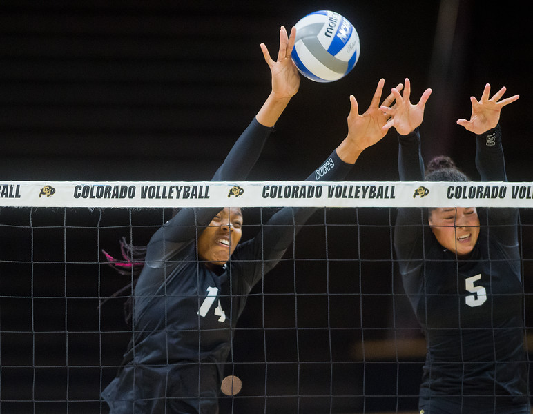 "Naghede Abu (left) and Justine Spann make a save during the volleyball scrimmage at the Coors Event Center at CU Boulder on Saturday.<br /> For more photos go to  <a href=""http://www.BoCoPreps.com"">http://www.BoCoPreps.com</a><br /> (Autumn Parry/Staff Photographer)<br /> August 20, 2016"