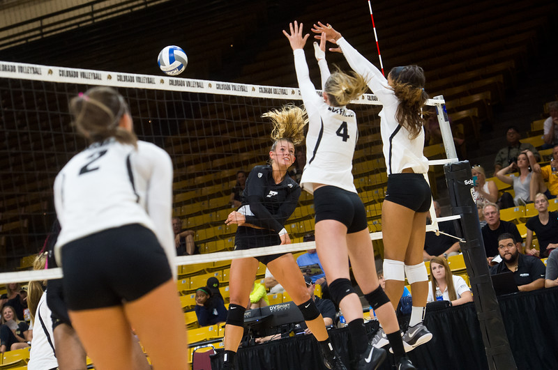 "Alexa Smith (left) tries to hit one past Anna Pfefferle during the volleyball scrimmage at the Coors Event Center at CU Boulder on Saturday.<br /> For more photos go to  <a href=""http://www.BoCoPreps.com"">http://www.BoCoPreps.com</a><br /> (Autumn Parry/Staff Photographer)<br /> August 20, 2016"