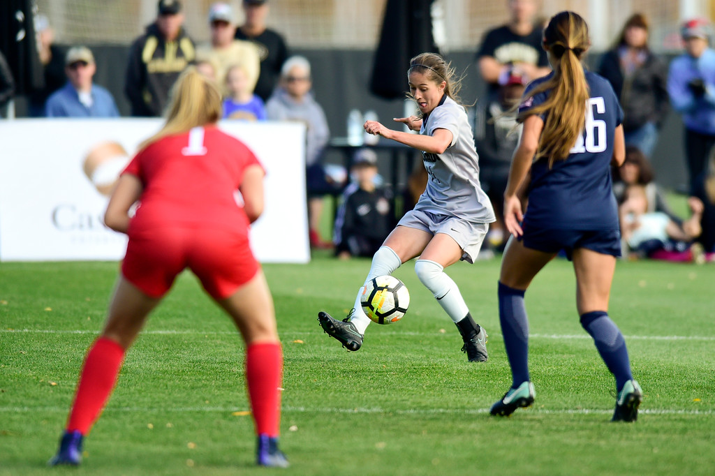 . University of Colorado Becca Rasmussen (No. 14) takes a shot on goal while University of Arizona goal keeper Lainey Burdett (No. 1) and Sabrina Enciso (No. 16) defend at Prentup Field in Boulder, Colorado on Oct. 22, 2017. (Photo by Matthew Jonas/Times-Call)