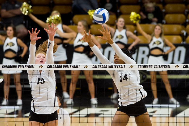"CU's Gabby Simpson (left) and Naghede Abu block a hit from Arizona during the game in the Coors Event Center at CU Boulder on Sunday. <br /> More photos:  <a href=""http://www.buffzone.com"">http://www.buffzone.com</a><br /> (Autumn Parry/Staff Photographer)<br /> September 25, 2016"