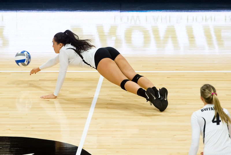 "CU's Kiara McKibben jumps to make a save during the game against Arizona in the Coors Event Center at CU Boulder on Sunday. <br /> More photos:  <a href=""http://www.buffzone.com"">http://www.buffzone.com</a><br /> (Autumn Parry/Staff Photographer)<br /> September 25, 2016"