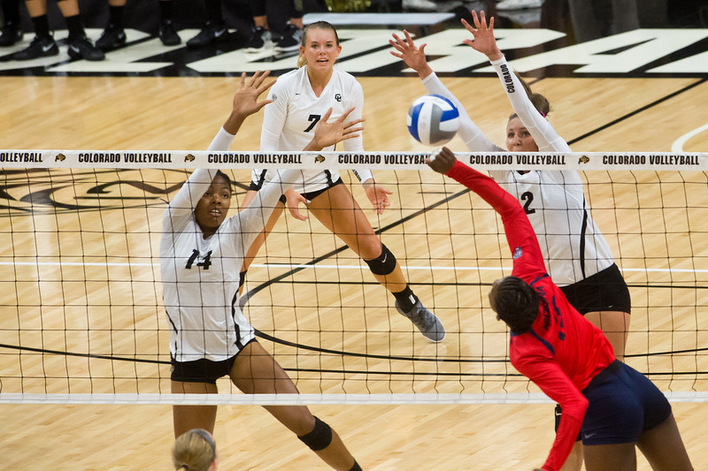 "CU's Naghede Abu (left) and Stephanie Shadley block a hit by Arizona during the game in the Coors Event Center at CU Boulder on Sunday. <br /> More photos:  <a href=""http://www.buffzone.com"">http://www.buffzone.com</a><br /> (Autumn Parry/Staff Photographer)<br /> September 25, 2016"