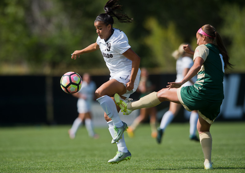 "CU's Stephanie Zuniga tries to keep the ball from CSU's defense during the soccer game at Prentup Field at CU Boulder on Sunday. CU Boulder defeated CSU 2-1.<br /> More photos:  <a href=""http://www.buffzone.com"">http://www.buffzone.com</a><br /> (Autumn Parry/Staff Photographer)<br /> August 21, 2016"
