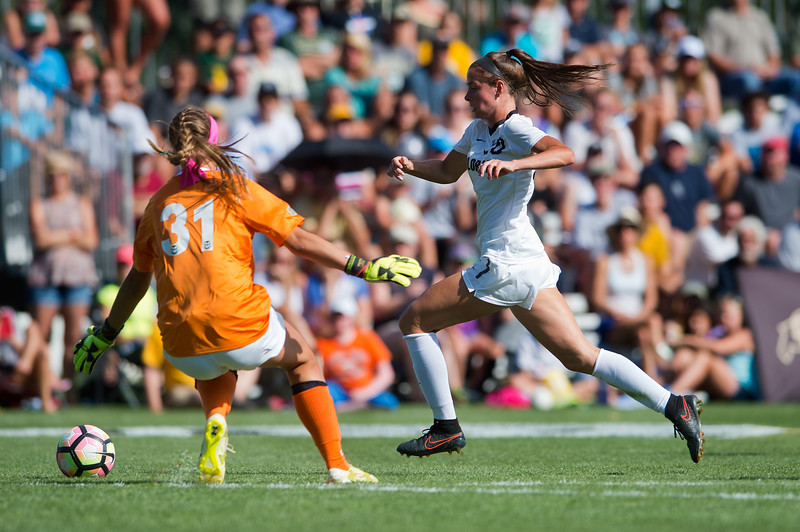 "CU's Camilla Shymka navigates past CSU's goalkeeper during the soccer game at Prentup Field at CU Boulder on Sunday. CU Boulder defeated CSU 2-1.<br /> More photos:  <a href=""http://www.buffzone.com"">http://www.buffzone.com</a><br /> (Autumn Parry/Staff Photographer)<br /> August 21, 2016"