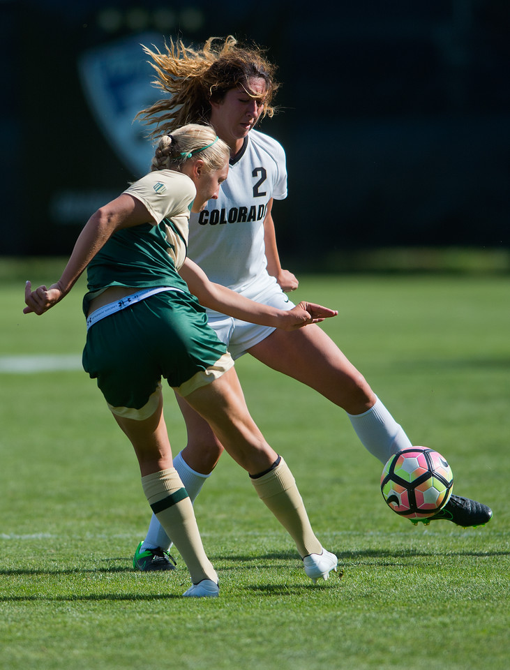 """CU's Joss Orejel kicks the ball past CSU's defense during the soccer game at Prentup Field at CU Boulder on Sunday. CU Boulder defeated CSU 2-1.<br /> More photos:  <a href=""""http://www.buffzone.com"""">http://www.buffzone.com</a><br /> (Autumn Parry/Staff Photographer)<br /> August 21, 2016"""