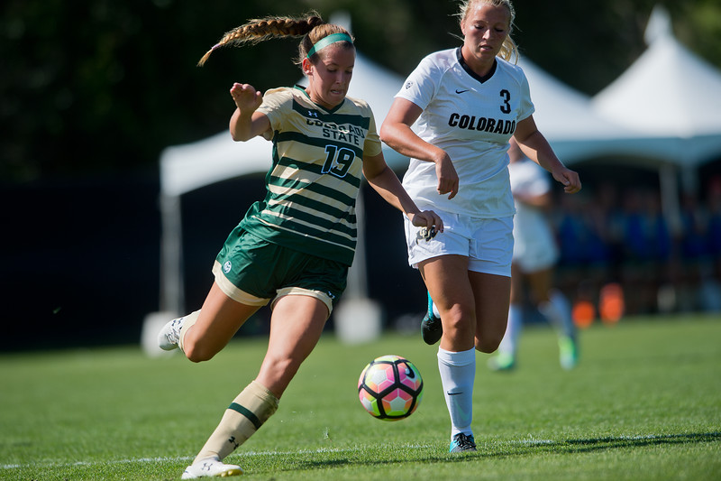 "CSU's Kasey Dietrich kicks the ball past CU's Emily Bruder during the soccer game at Prentup Field at CU Boulder on Sunday. CU Boulder defeated CSU 2-1.<br /> More photos:  <a href=""http://www.buffzone.com"">http://www.buffzone.com</a><br /> (Autumn Parry/Staff Photographer)<br /> August 21, 2016"