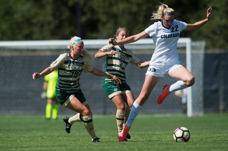 """CU's Taylor Kornieck tries to maintain possession of the ball during the soccer game at Prentup Field at CU Boulder on Sunday. CU Boulder defeated CSU 2-1.<br /> More photos:  <a href=""""http://www.buffzone.com"""">http://www.buffzone.com</a><br /> (Autumn Parry/Staff Photographer)<br /> August 21, 2016"""