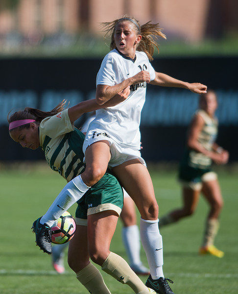 """CU's Sarah Kinzner jumps for the ball during the soccer game at Prentup Field at CU Boulder on Sunday. CU Boulder defeated CSU 2-1.<br /> More photos:  <a href=""""http://www.buffzone.com"""">http://www.buffzone.com</a><br /> (Autumn Parry/Staff Photographer)<br /> August 21, 20161"""