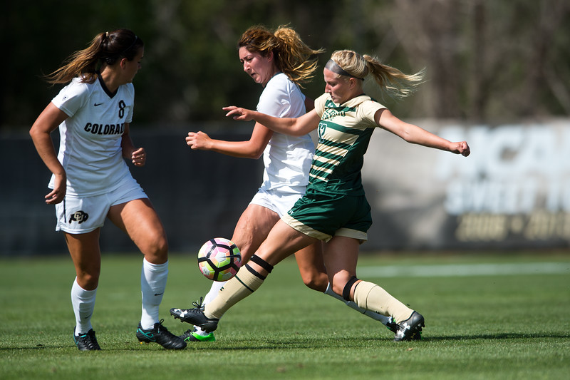 "CU's Joss Orejel (center) and Megan Massey (right) try to gain possession of the ball from CSU's Taylor Nelson during the soccer game at Prentup Field at CU Boulder on Sunday. CU Boulder defeated CSU 2-1.<br /> More photos:  <a href=""http://www.buffzone.com"">http://www.buffzone.com</a><br /> (Autumn Parry/Staff Photographer)<br /> August 21, 2016"