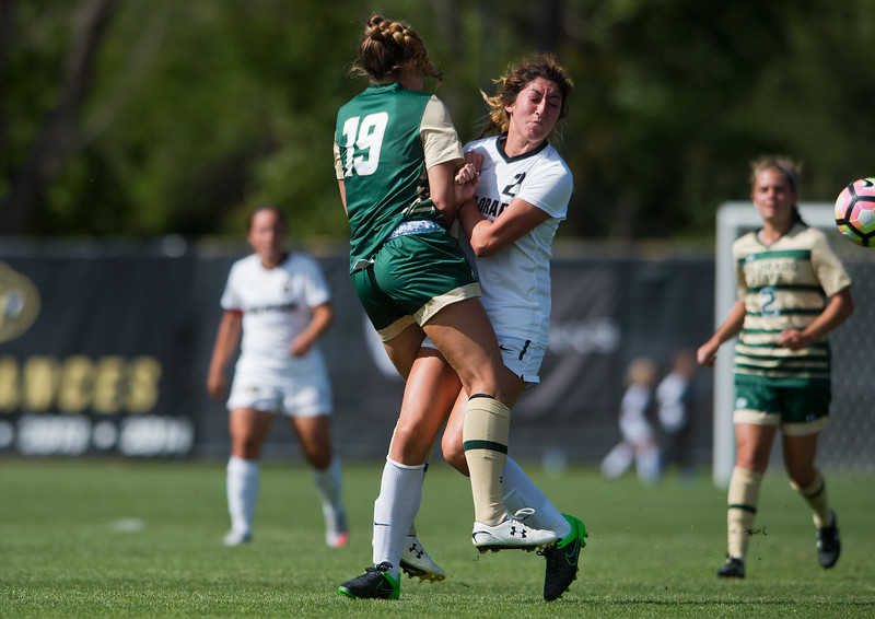 "CU's Joss Orejel and CSU's Kasey Dietrich collide  during the soccer game at Prentup Field at CU Boulder on Sunday. CU Boulder defeated CSU 2-1.<br /> More photos:  <a href=""http://www.buffzone.com"">http://www.buffzone.com</a><br /> (Autumn Parry/Staff Photographer)<br /> August 21, 2016"