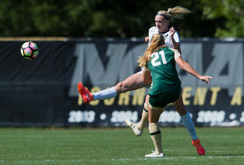 "CU's Taylor Kornieck kicks the ball past CSU's Halley Havlicek during the soccer game at Prentup Field at CU Boulder on Sunday. CU Boulder defeated CSU 2-1.<br /> More photos:  <a href=""http://www.buffzone.com"">http://www.buffzone.com</a><br /> (Autumn Parry/Staff Photographer)<br /> August 21, 2016"