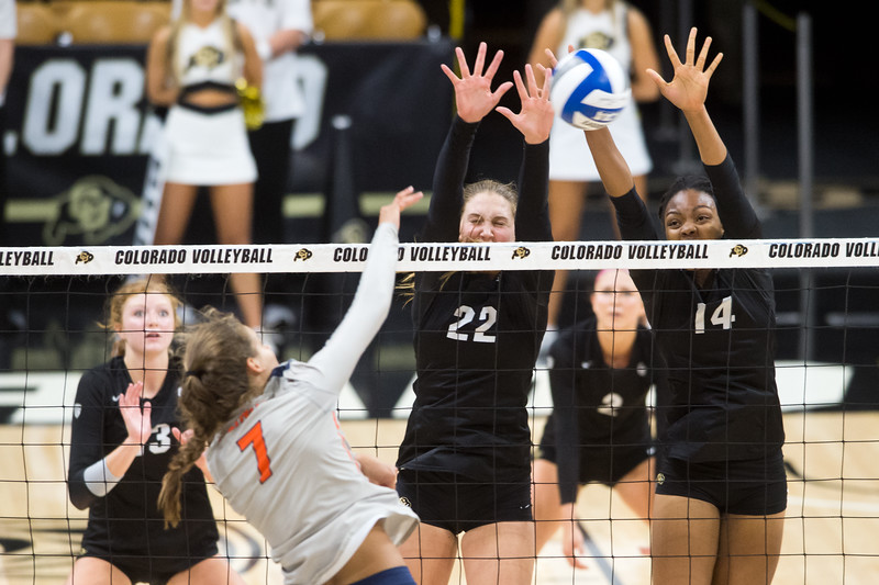"CU's Joslyn Hayes (left) and Naghede Abu block the ball during the game against Illinois at the Coors Event Center at CU Boulder on Sunday. <br /> More photos:  <a href=""http://www.BuffZone.com"">http://www.BuffZone.com</a><br /> (Autumn Parry/Staff Photographer)<br /> September 4, 2016"