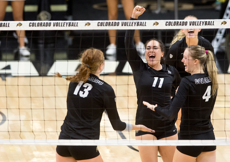 "CU's Kiara McKibben (center) celebrates with Gabby Simpson (left) and Anna Pfefferle (right) after they scored against Illinois during the gameat the Coors Event Center at CU Boulder on Sunday. <br /> More photos:  <a href=""http://www.BuffZone.com"">http://www.BuffZone.com</a><br /> (Autumn Parry/Staff Photographer)<br /> September 4, 2016"