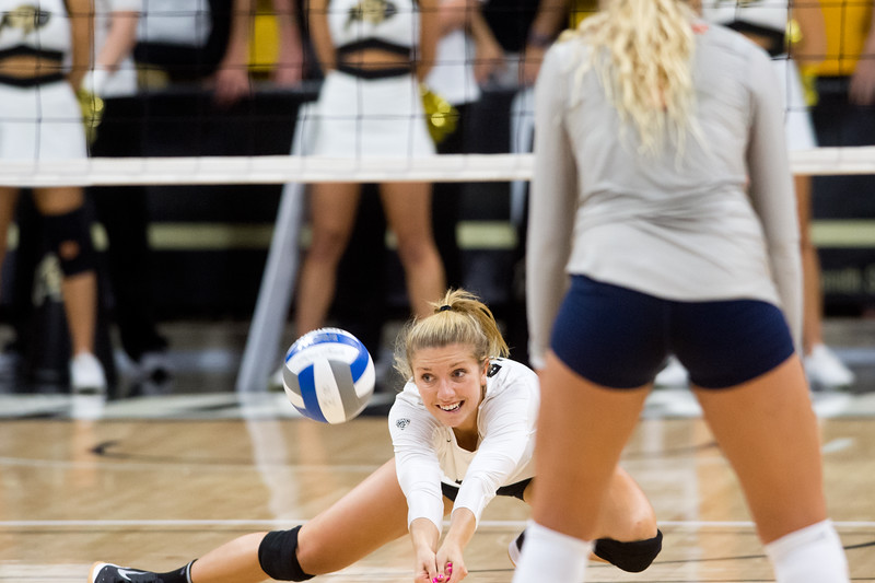"CU's Cierra Simpson dives to make a save during the game against Illinois at the Coors Event Center at CU Boulder on Sunday. <br /> More photos:  <a href=""http://www.BuffZone.com"">http://www.BuffZone.com</a><br /> (Autumn Parry/Staff Photographer)<br /> September 4, 2016"