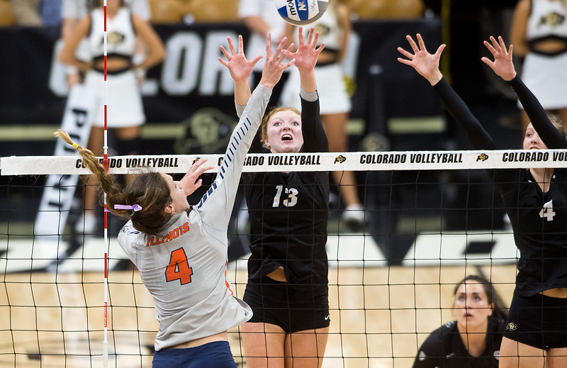 "CU's Gabby Simpson blocks the ball during the game against Illinois at the Coors Event Center at CU Boulder on Sunday. <br /> More photos:  <a href=""http://www.BuffZone.com"">http://www.BuffZone.com</a><br /> (Autumn Parry/Staff Photographer)<br /> September 4, 2016"