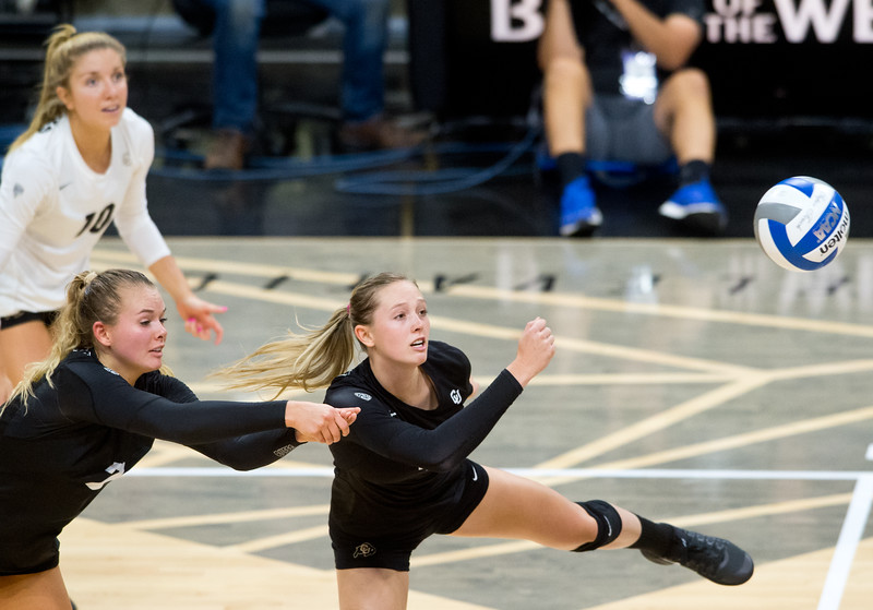 "CU's Alexa Smith (left) and Anna Pfefferle dive to make a save during the game against Illinois at the Coors Event Center at CU Boulder on Sunday. <br /> More photos:  <a href=""http://www.BuffZone.com"">http://www.BuffZone.com</a><br /> (Autumn Parry/Staff Photographer)<br /> September 4, 2016"