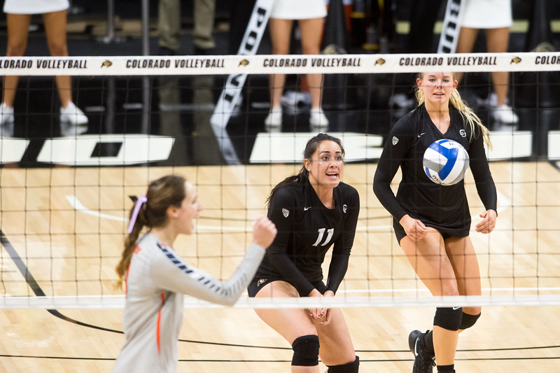 "CU's Kiara McKibben (center) makes a save during the game against Illinois at the Coors Event Center at CU Boulder on Sunday. <br /> More photos:  <a href=""http://www.BuffZone.com"">http://www.BuffZone.com</a><br /> (Autumn Parry/Staff Photographer)<br /> September 4, 2016"