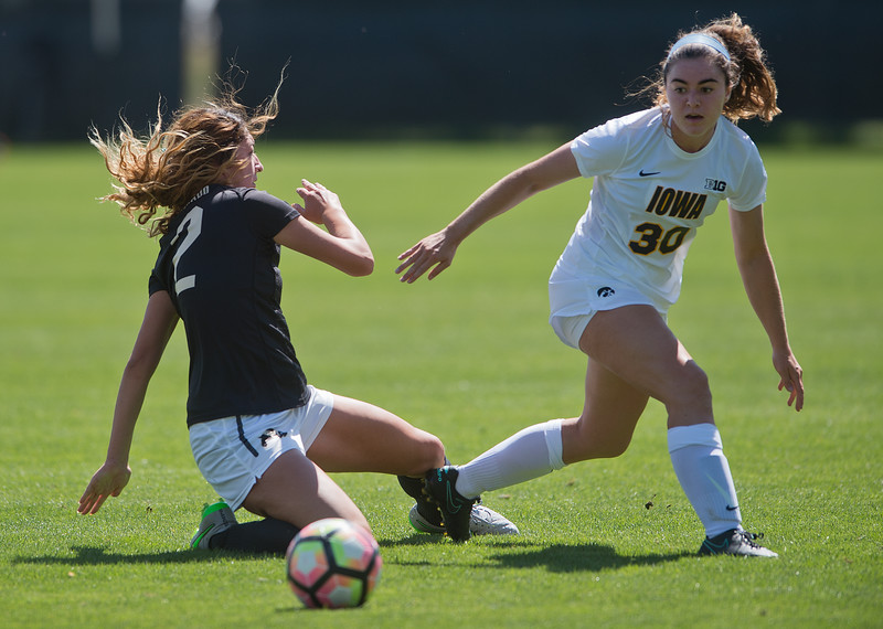 "CU's Joss Orejel falls as Iowa's Devin Burns goes after the ball during the game at Prentup Field at CU Boulder on Sunday. CU defeated Iowa 4-1.<br /> More photos:  <a href=""http://www.buffzone.com"">http://www.buffzone.com</a><br /> (Autumn Parry/Staff Photographer)<br /> September 11, 2016"