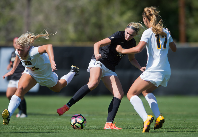 "Iowa's Tory Harman trips over CU's Taylor Kornieck as Kornieck takes possession of the ball during the game at Prentup Field at CU Boulder on Sunday. CU defeated Iowa 4-1.<br /> More photos:  <a href=""http://www.buffzone.com"">http://www.buffzone.com</a><br /> (Autumn Parry/Staff Photographer)<br /> September 11, 2016"