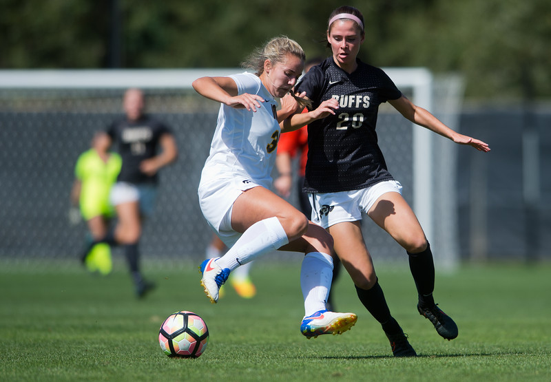 "CU's Camilla Shymka and Iowa's Corey Burns go after the ball during the game at Prentup Field at CU Boulder on Sunday.  CU defeated Iowa 4-1.<br /> More photos:  <a href=""http://www.buffzone.com"">http://www.buffzone.com</a><br /> (Autumn Parry/Staff Photographer)<br /> September 11, 2016"