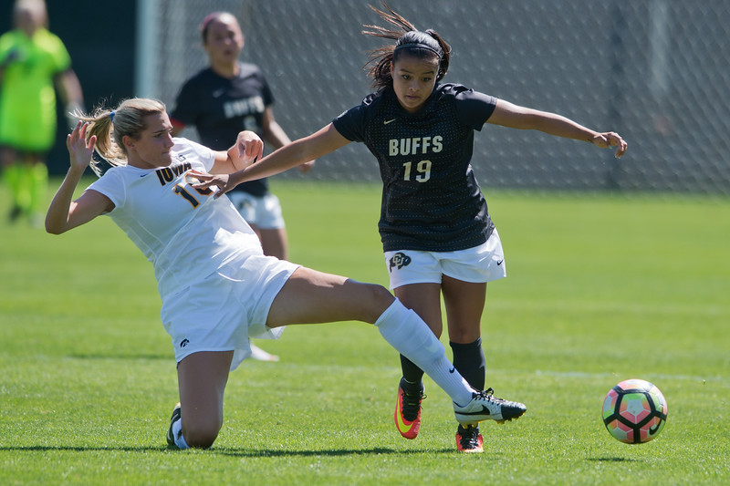 "CU's Stephanie Zuniga pushes Iowa's Natalie Krygier as she goes after the ball during the game at Prentup Field at CU Boulder on Sunday. CU defeated Iowa 4-1.<br /> More photos:  <a href=""http://www.buffzone.com"">http://www.buffzone.com</a><br /> (Autumn Parry/Staff Photographer)<br /> September 11, 2016"