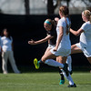 "CU's Danica Evans kicks the ball past Iowa's defense during the game at Prentup Field at CU Boulder on Sunday. CU defeated Iowa 4-1.<br /> More photos:  <a href=""http://www.buffzone.com"">http://www.buffzone.com</a><br /> (Autumn Parry/Staff Photographer)<br /> September 11, 2016"