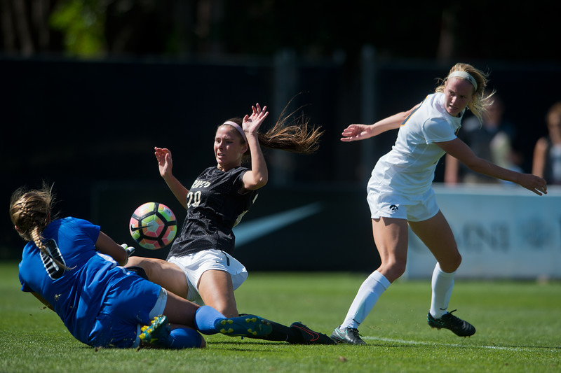 "CU's Camilla Shymka slides into Iowa's goalkeeper, Emma Rigby, as she scores against Iowa during the second half of the game at Prentup Field at CU Boulder on Sunday. CU defeated Iowa 4-1.<br /> More photos:  <a href=""http://www.buffzone.com"">http://www.buffzone.com</a><br /> (Autumn Parry/Staff Photographer)<br /> September 11, 2016"