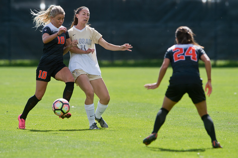 "Oregon State's Helene Haavik pushes CU's Kelsey Aaknes away from the ball during the game in Prentup Field at CU Boulder on Sunday. CU defeated Oregon State 3-0. <br /> More photos:  <a href=""http://www.buffzone.com"">http://www.buffzone.com</a><br /> (Autumn Parry/Staff Photographer)<br /> October 9, 2016"